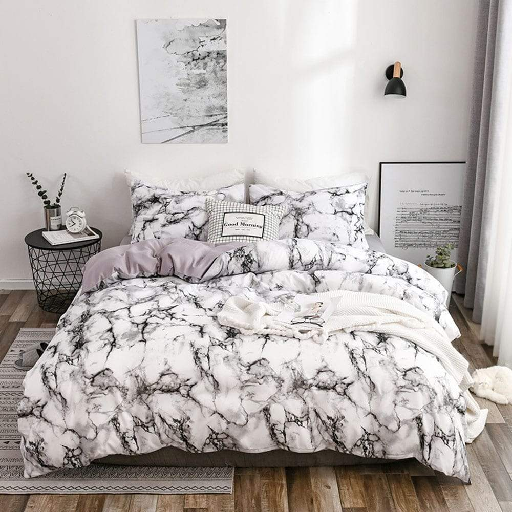 The Bedroom Bedding Is A Comfortable White Marble