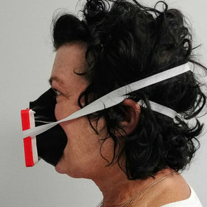 Woman Wearing Black Red 3D Mask Side View