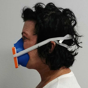 Woman Wearing Blue Orange 3D Mask Side View
