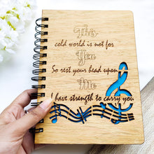 Load image into Gallery viewer, Laser cut and engraved wooden diary with musical quote and design