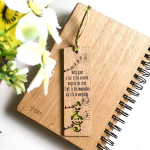 Laser cut and engraved wooden diary with musical quote and design