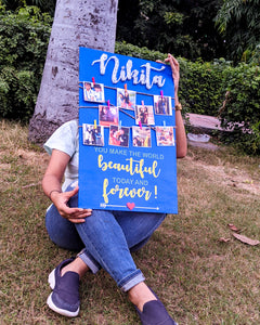 Blue wooden board with photos and string art