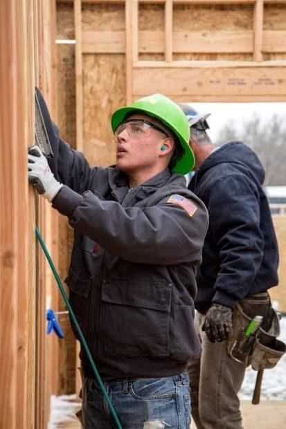POST INDEPENDENT- Photos: CMC, high school students volunteer with Habitat for Humanity