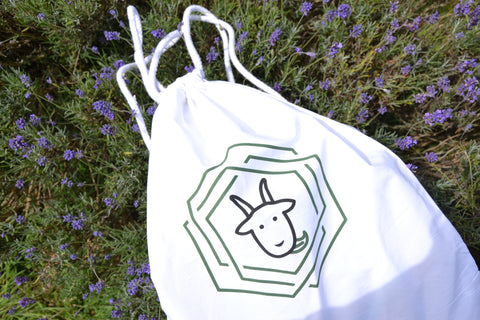 Cotton Sack, Not a fan of heavy bags with thousands of pockets? This super light weight drawstring bag is your eco-friendly solution!  Made with bright, white 100% cotton, this accessory is perfect for any activity: gym, park, work and so on.  Printed in UK.