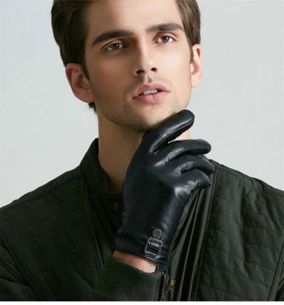 man wearing leather gloves