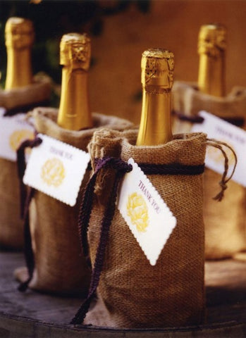 wine bottles in burlap bags