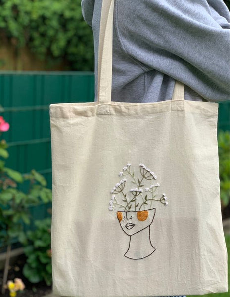 white embroidered flower tote bag