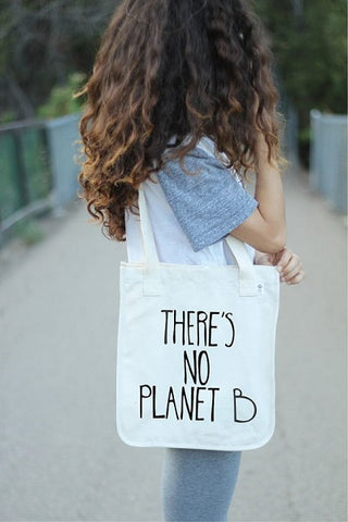 girl wearing white reusable tote bag