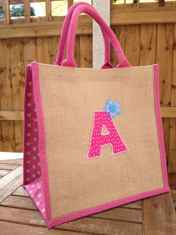 brown and pink jute tote bag with applique details