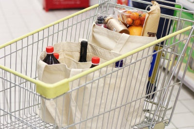 canvas shopping bags in cart