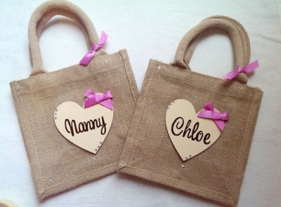 pair of monogrammed burlap totes with studs