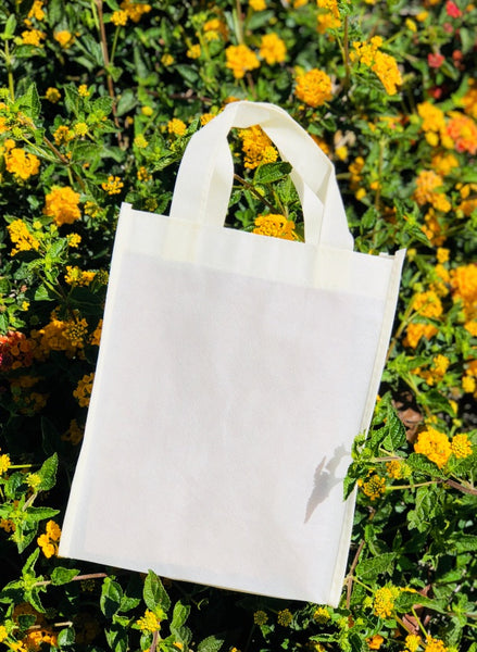 plain canvas tote bag on flower field