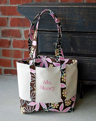 tote bag with flower details and pink monogram