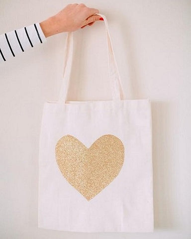 white tote bag with golden glitter heart