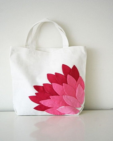 white tote bag with red flower