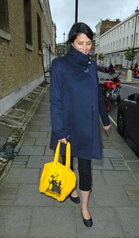 Sadie Frost wearing bright yellow tote bag
