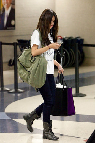 Selena Gomez carrying two bags