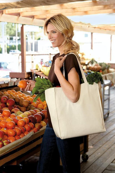 woman shopping with natural canvas tote bag