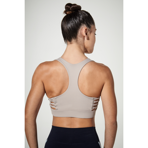 Shop the latest styles in women's sports bras at Studio 128.