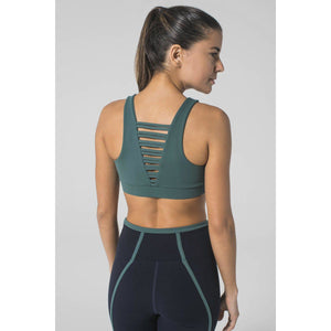 Stylish strappy sports bras available at Studio 128.