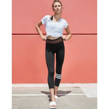 Load image into Gallery viewer, Fashionable black leggings with a twist from Studio 128.