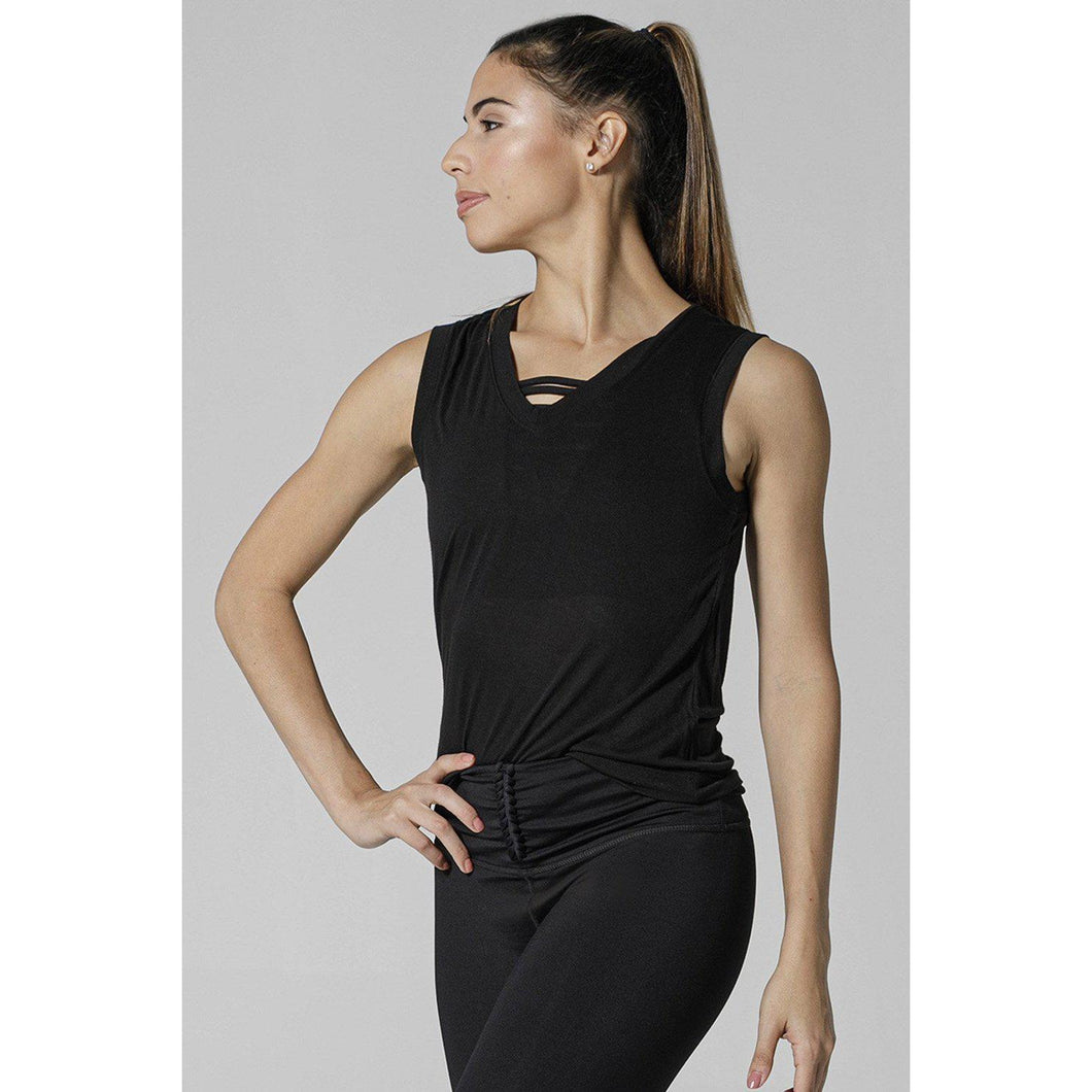 Simple black workout tops available at Studio 128.