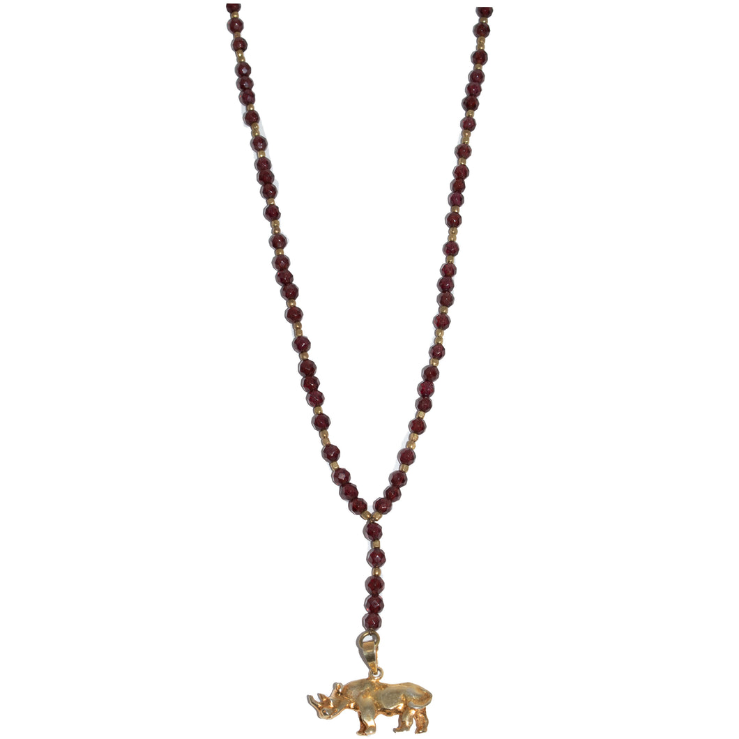 RUBY BEADED NECKLACE, GOLD RHINO PENDANT