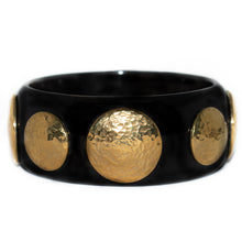 Load image into Gallery viewer, DUARA DARK HORN BANGLE, HAMMERED GOLD TONE BRASS DISCS.