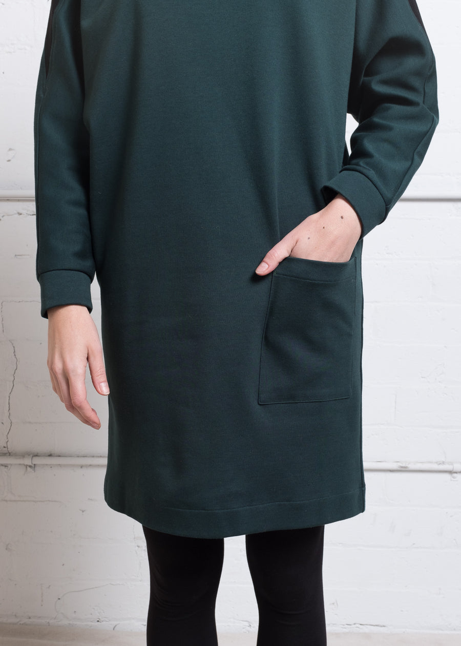Deep green cotton sweater dress with pockets.
