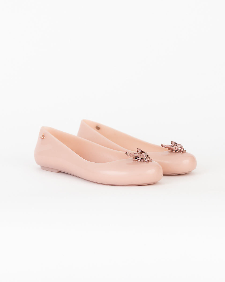 Light pink flats with sparkly bees.