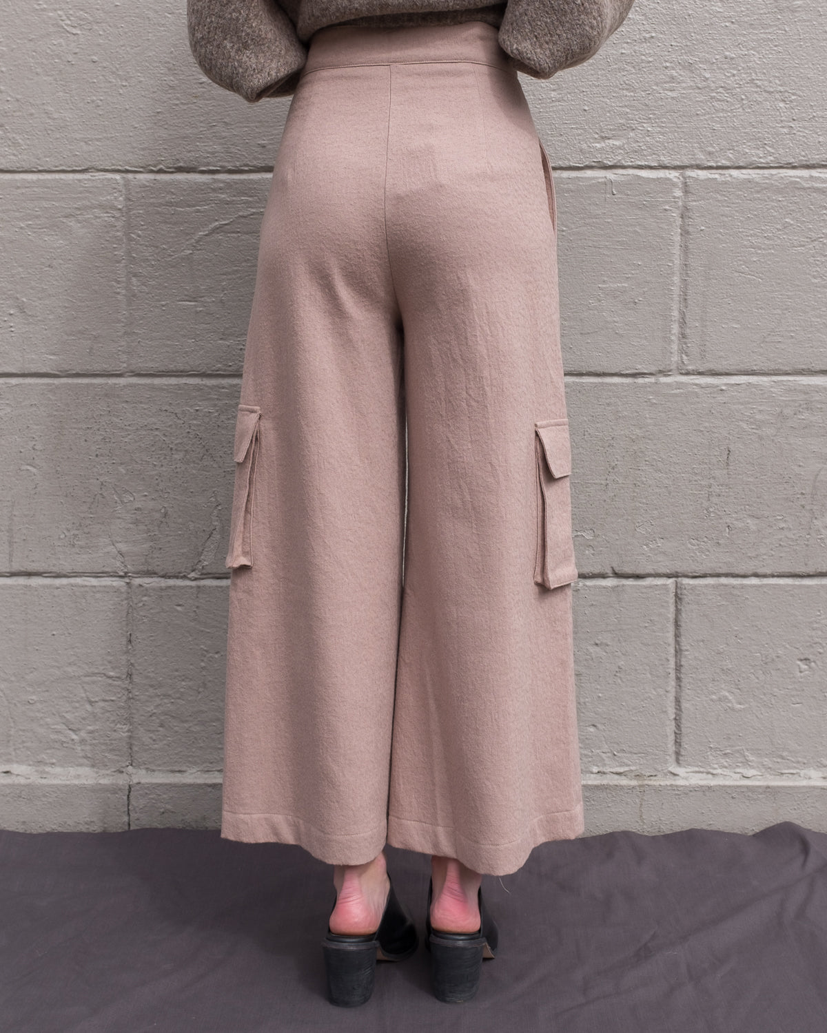 Light pink wide leg wooly pants.