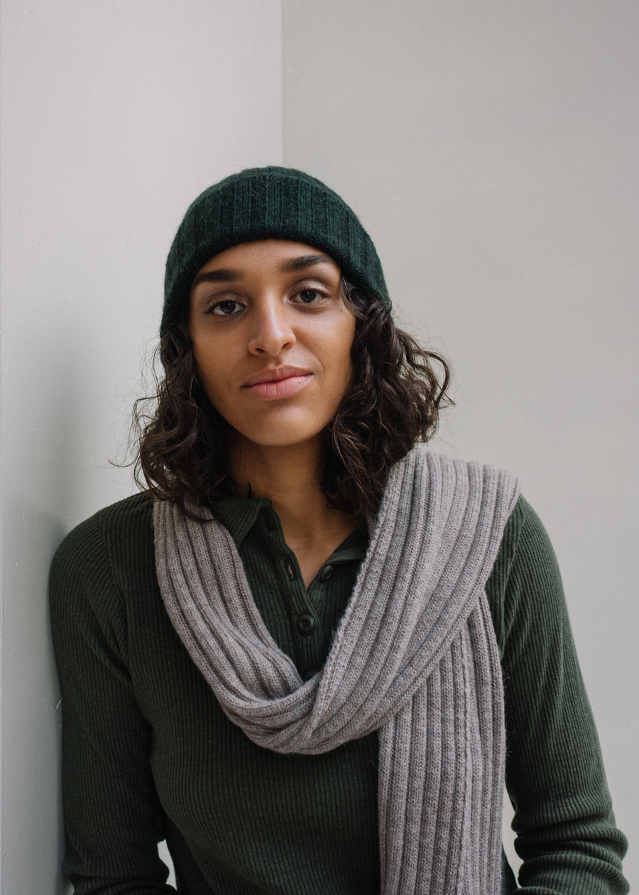 Dark green ribbed alpaca scarf.