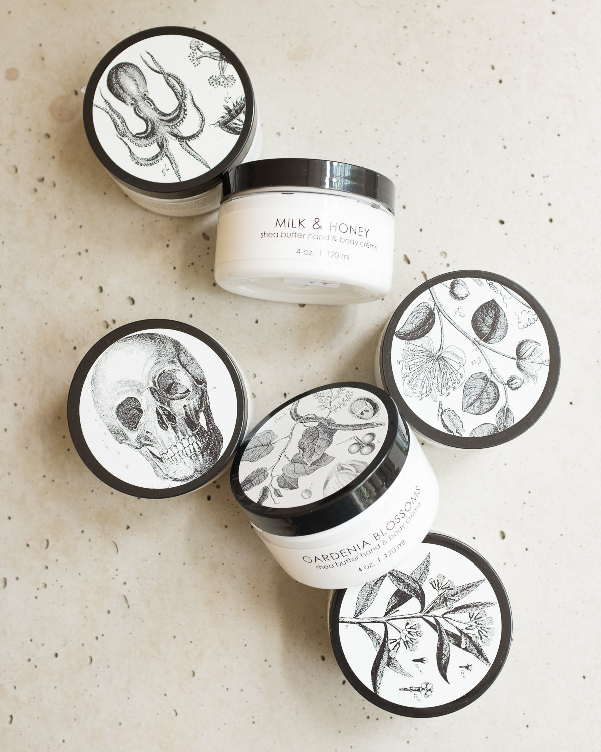 Hand cream in black and white jars.