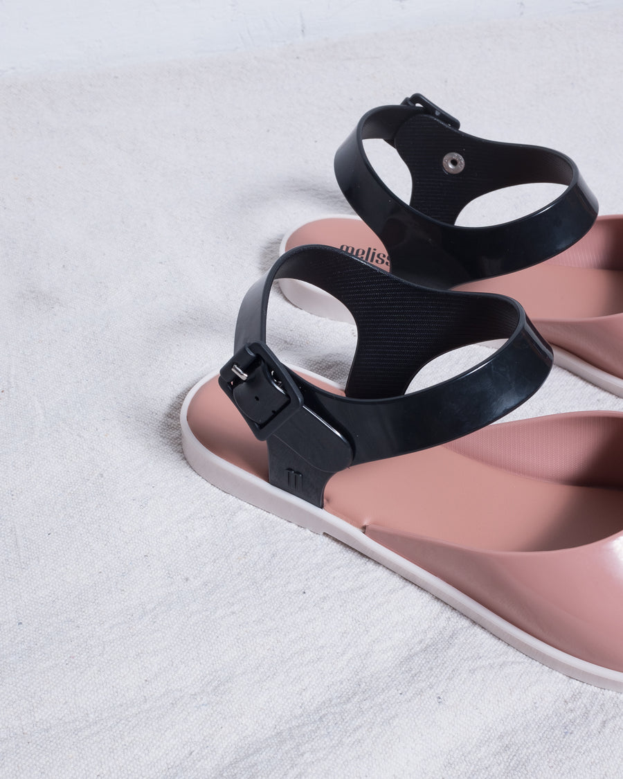 Strappy mauve and black PVC sandal.