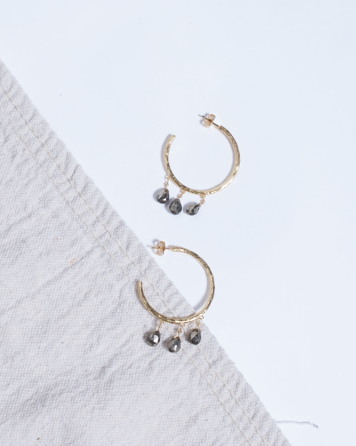 Gold hoops with three gray drops.