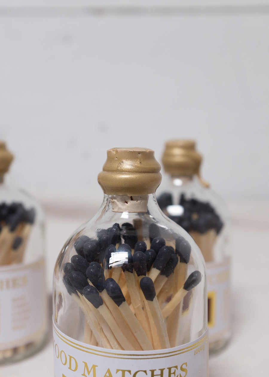 Matches in glass bottles.