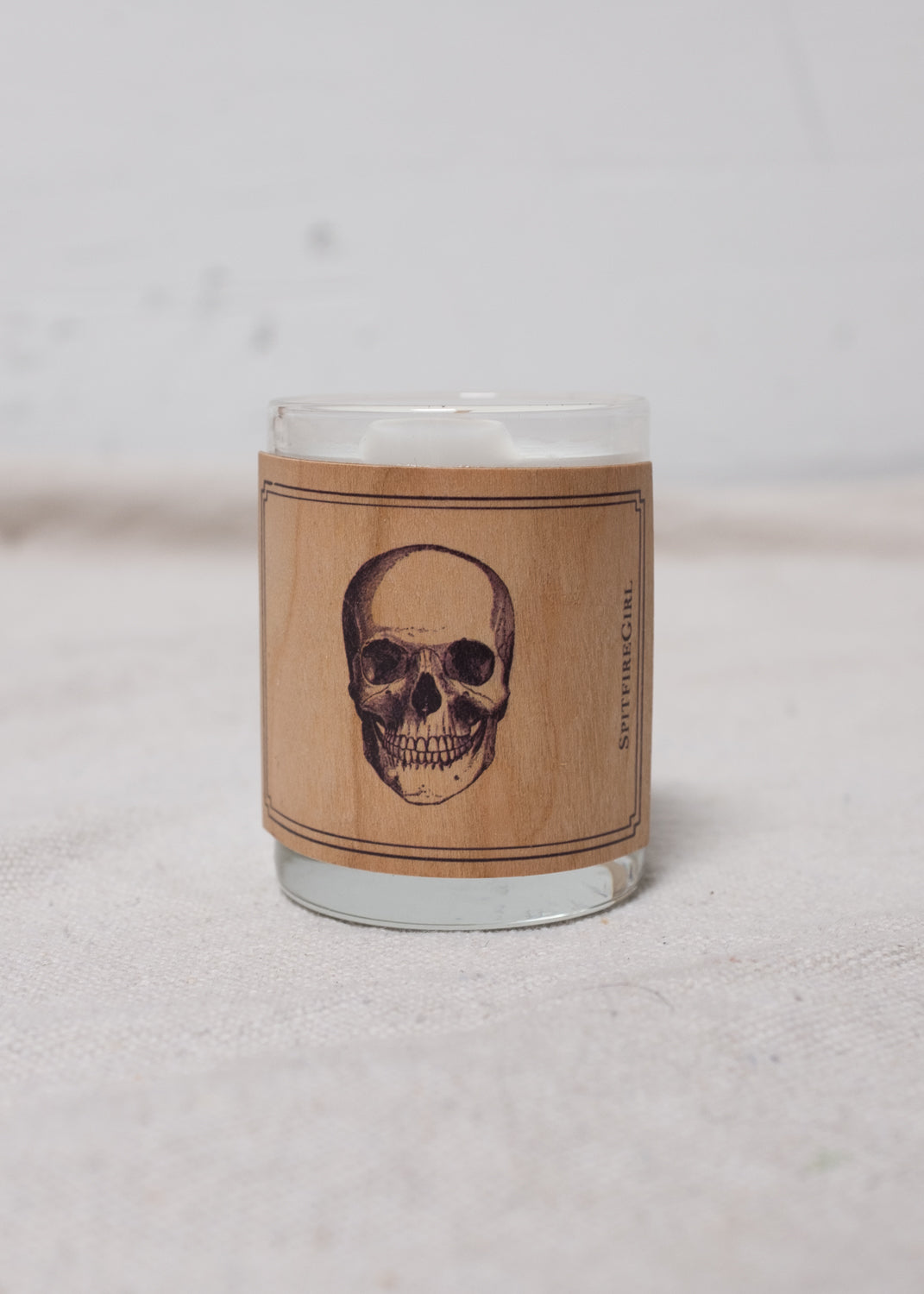 Candle with skull casing.