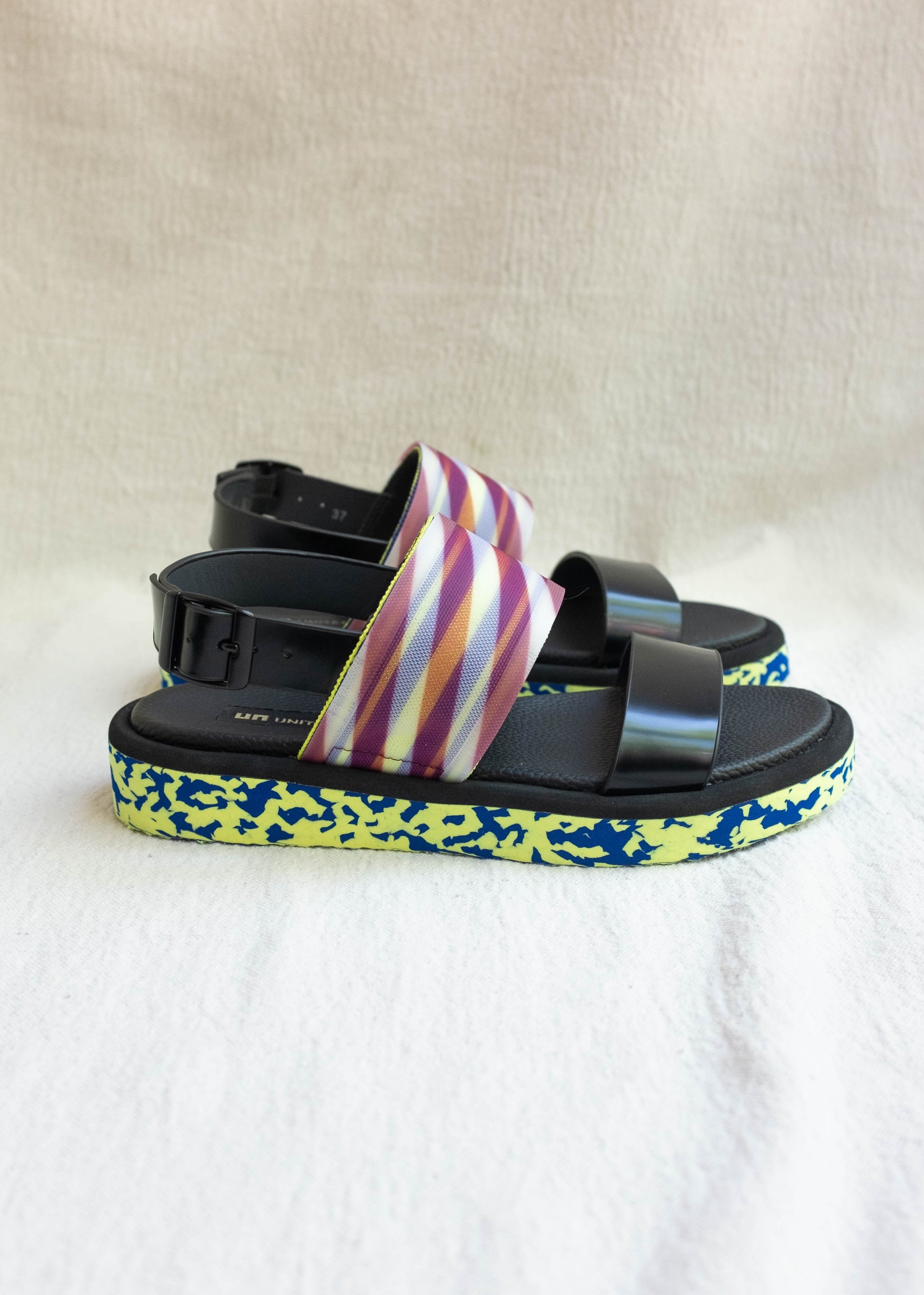 Side view of two strap sandal, mesh detail and EVA sole