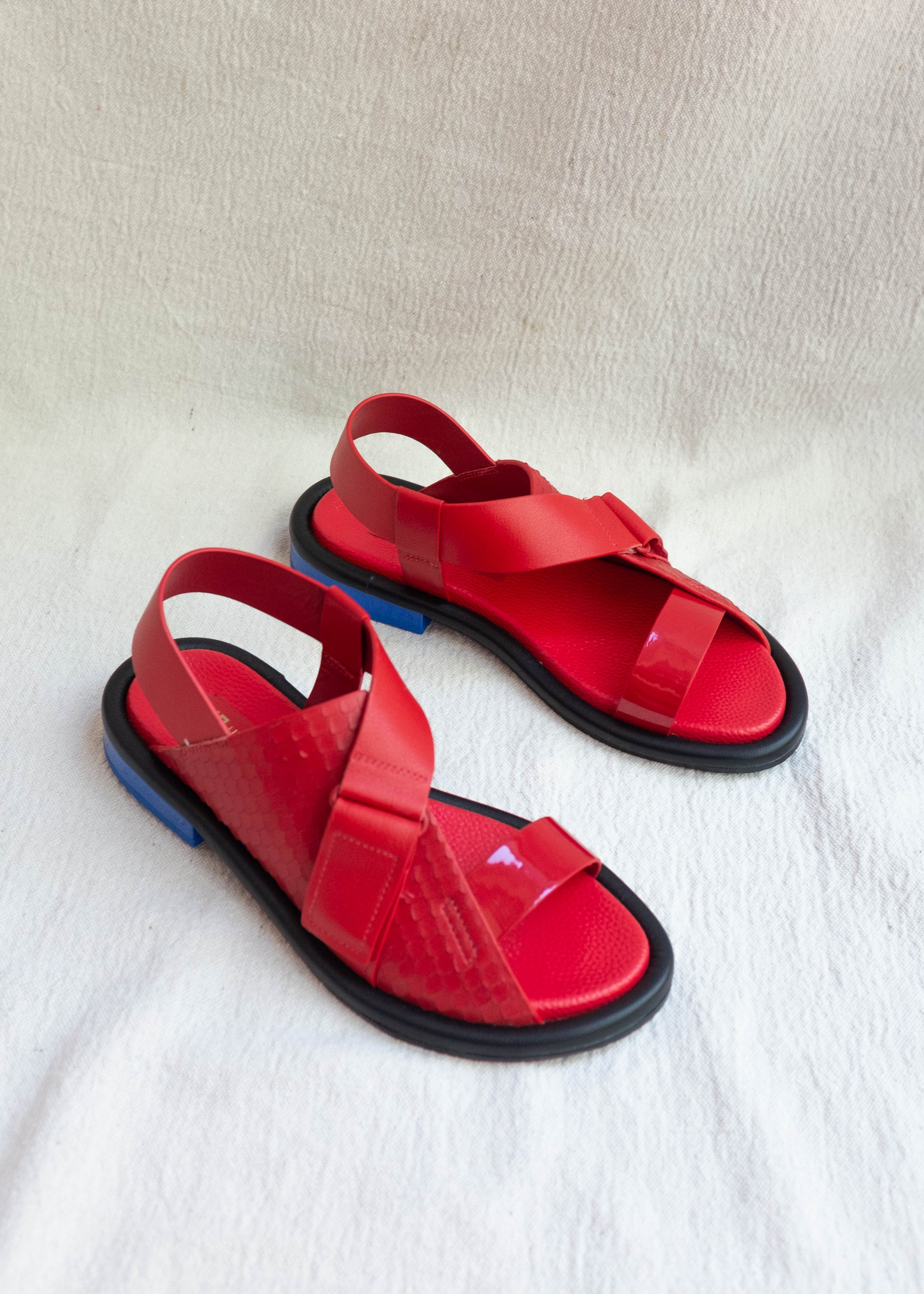 Overheard view of flame red strapy sandal , wrap around strap
