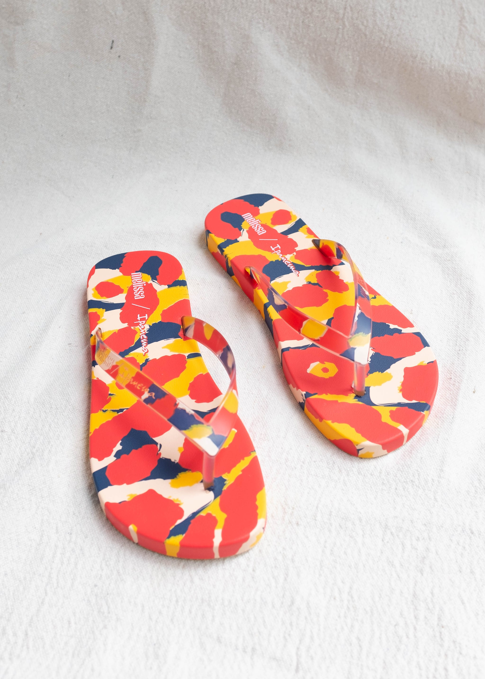 Overhead view of primary color leopard pattern flip flop.