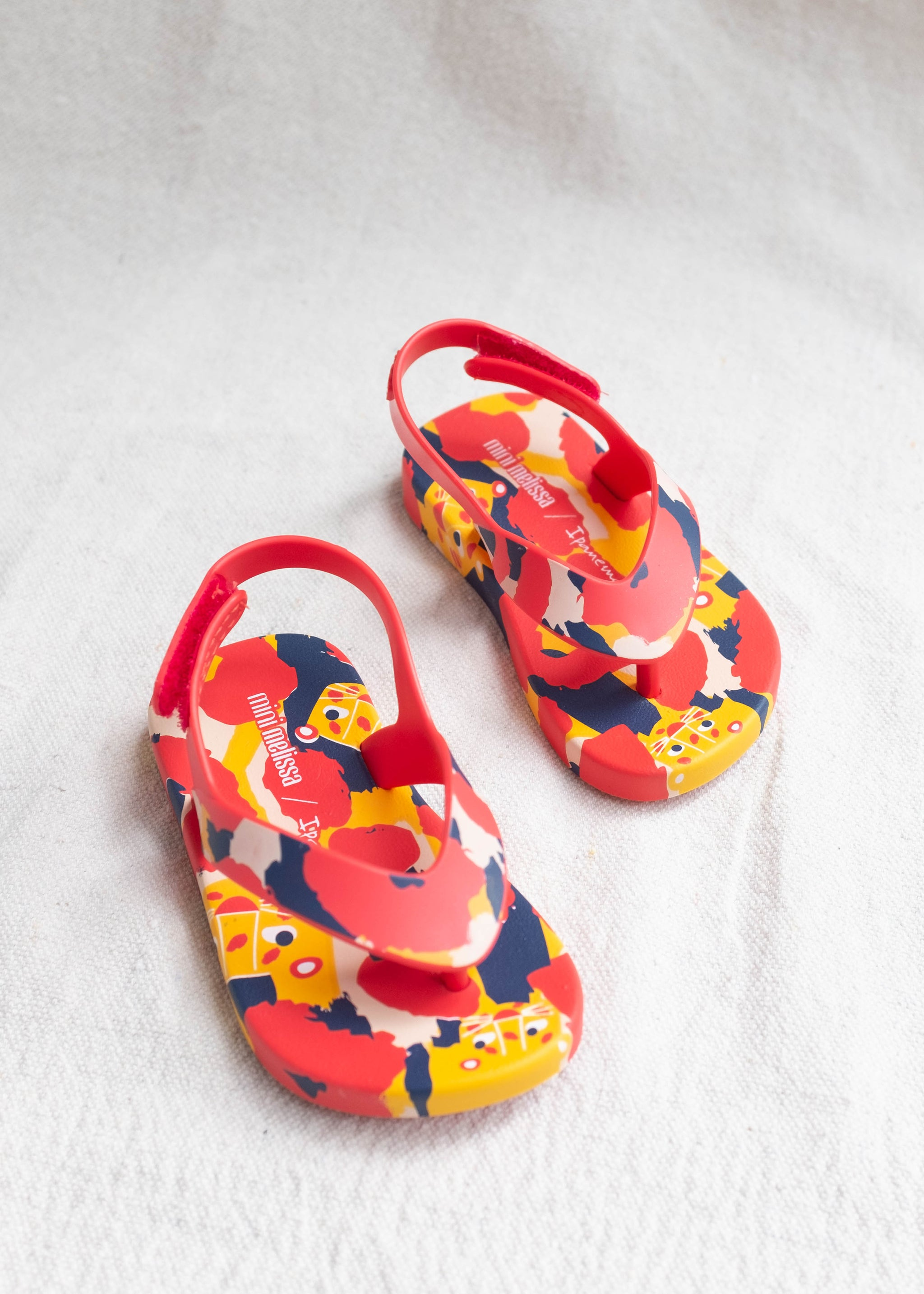 Overhead view of primary color leopard pattern child's flip flop.