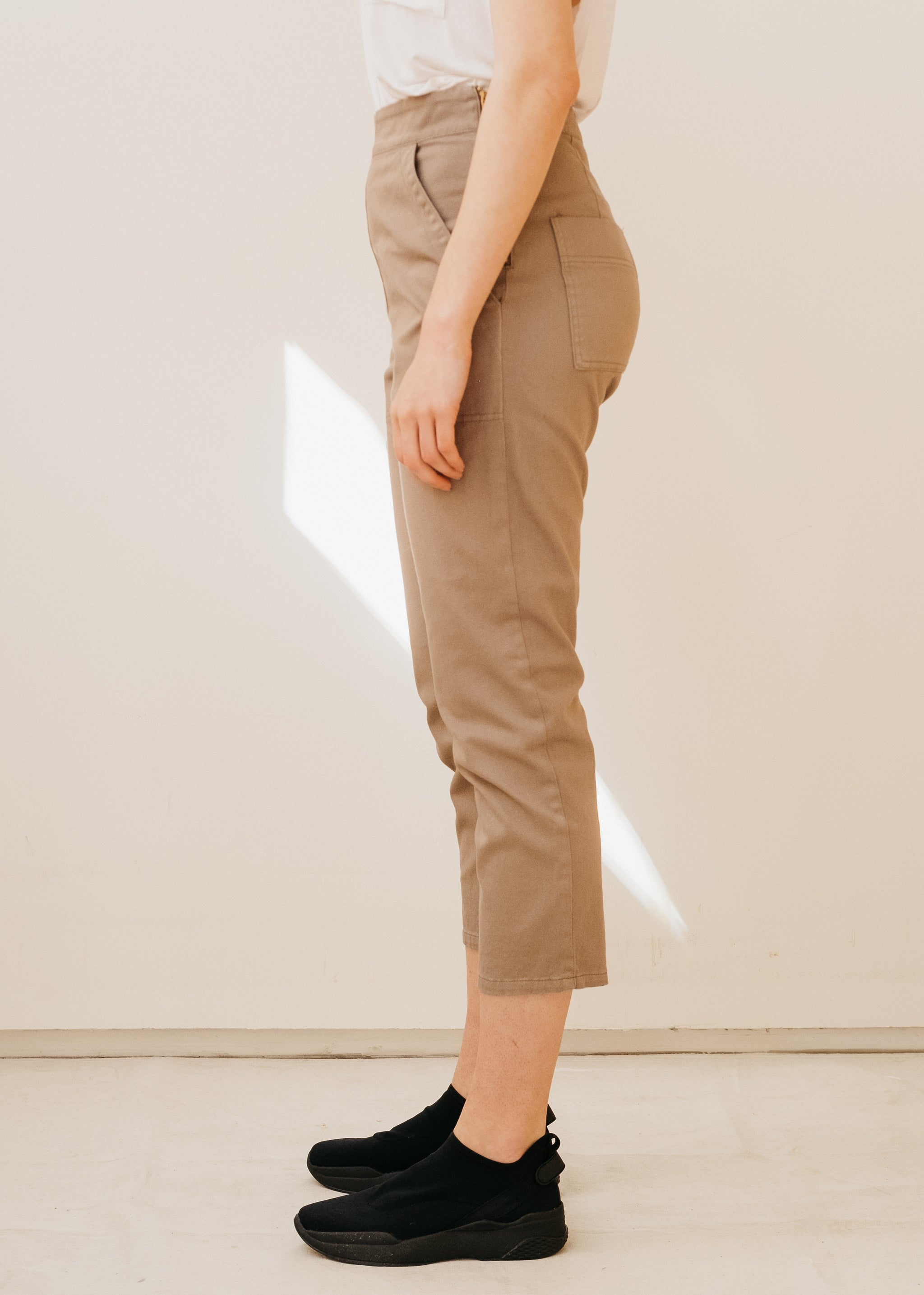 Side view of light brown skinny trousers, cropped