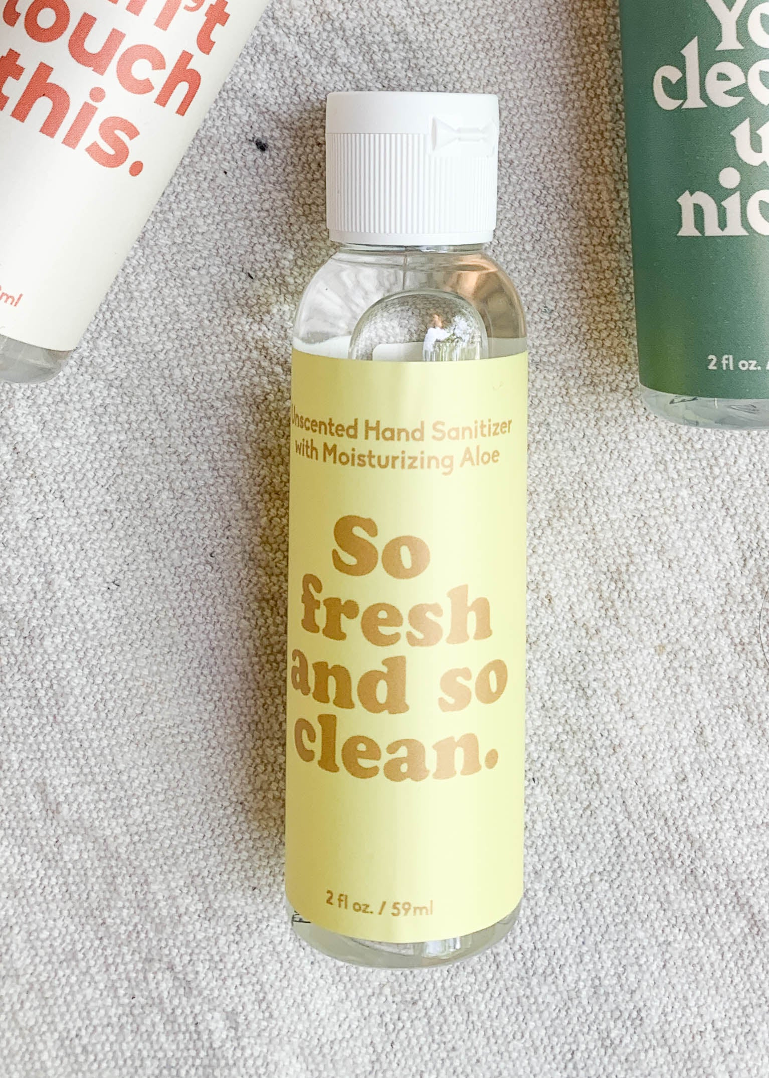 "Front view of yellow label hand sanitizer with ""So fresh and so clean"" printed in a dark yellow."