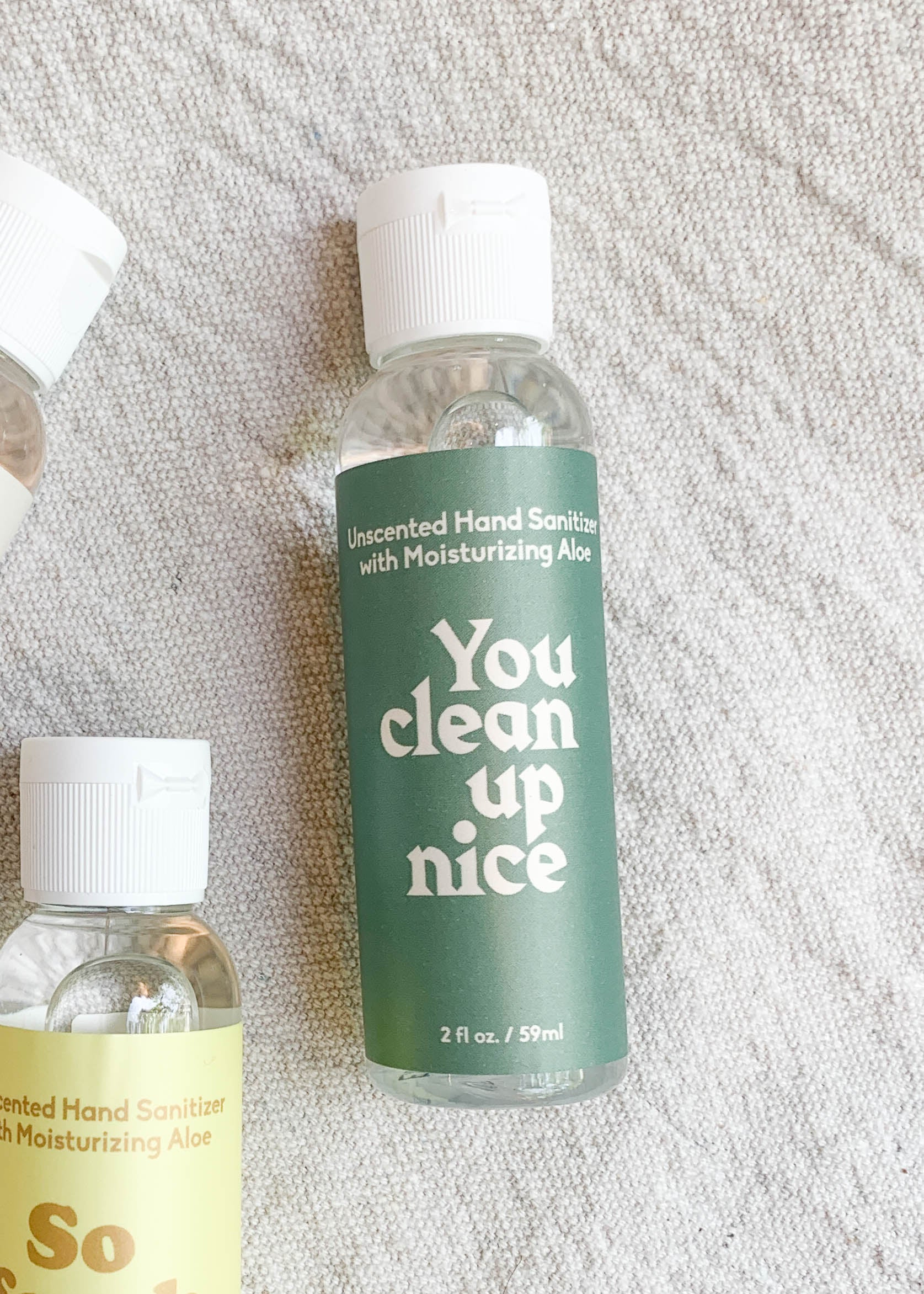 "Front view of green labeled hand sanitizer bottle with ""you clean up nice"" written in white print."
