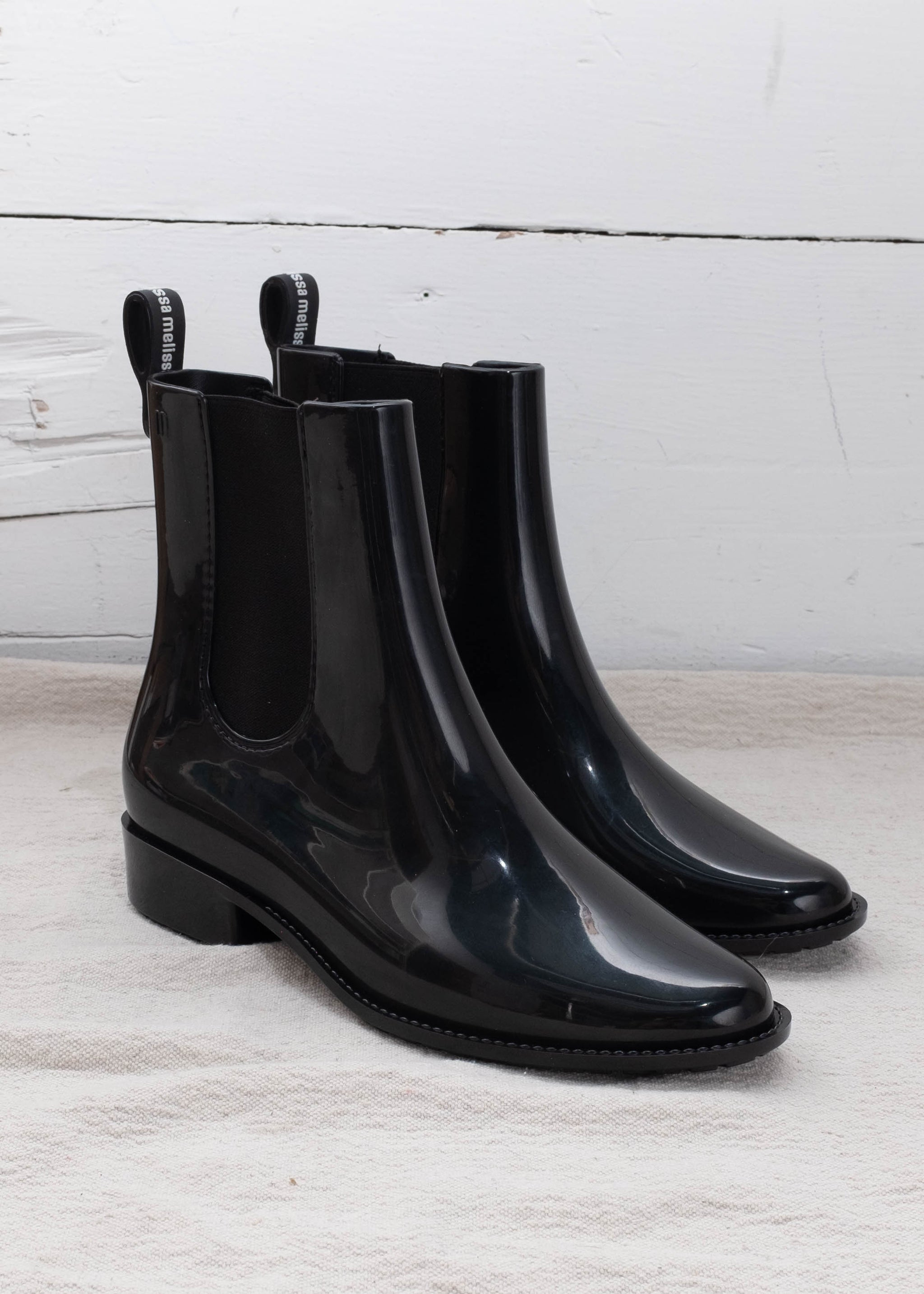"Black PVC boots with 1"" heel."