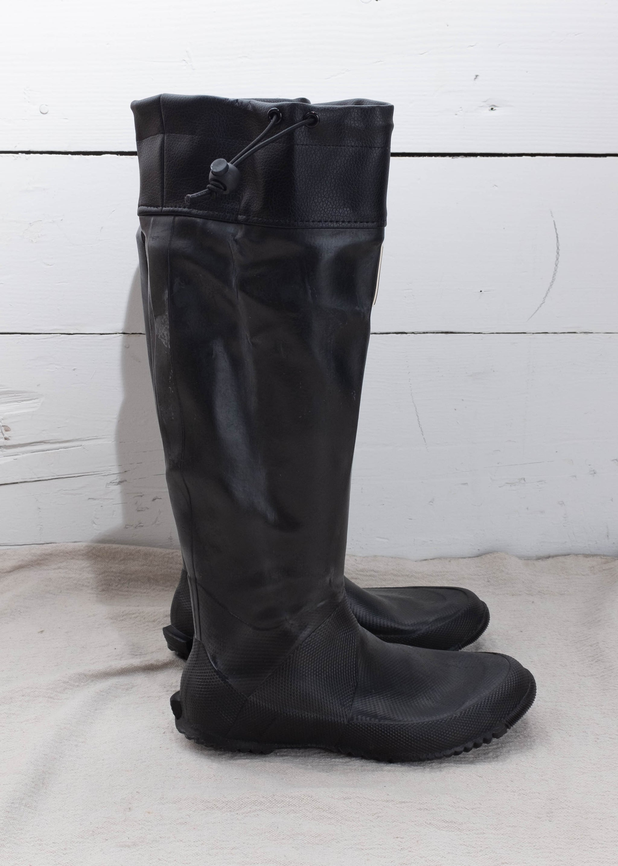Black heavy duty rain boots with drawstring.