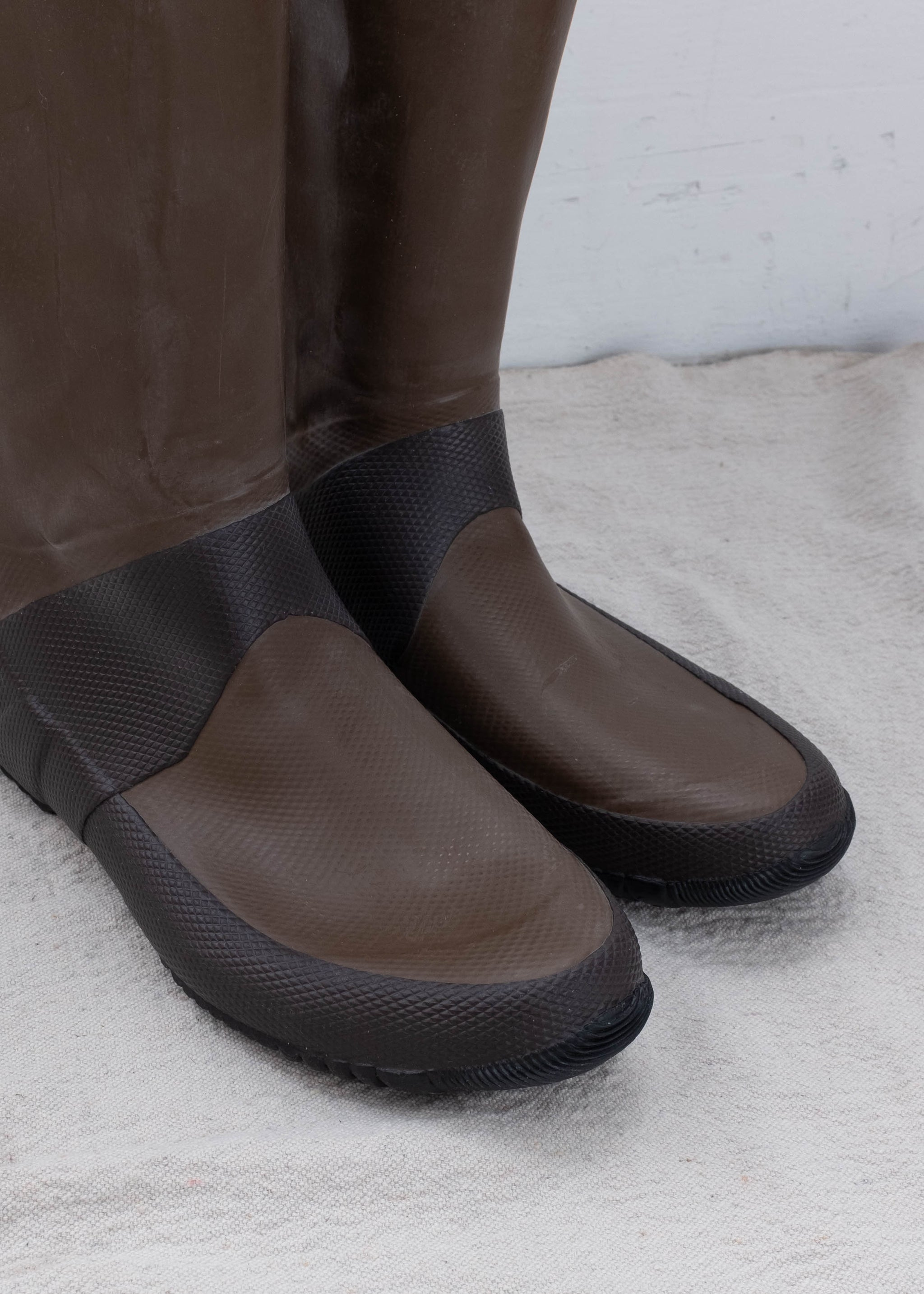 Brown heavy duty rain boots with drawstring.