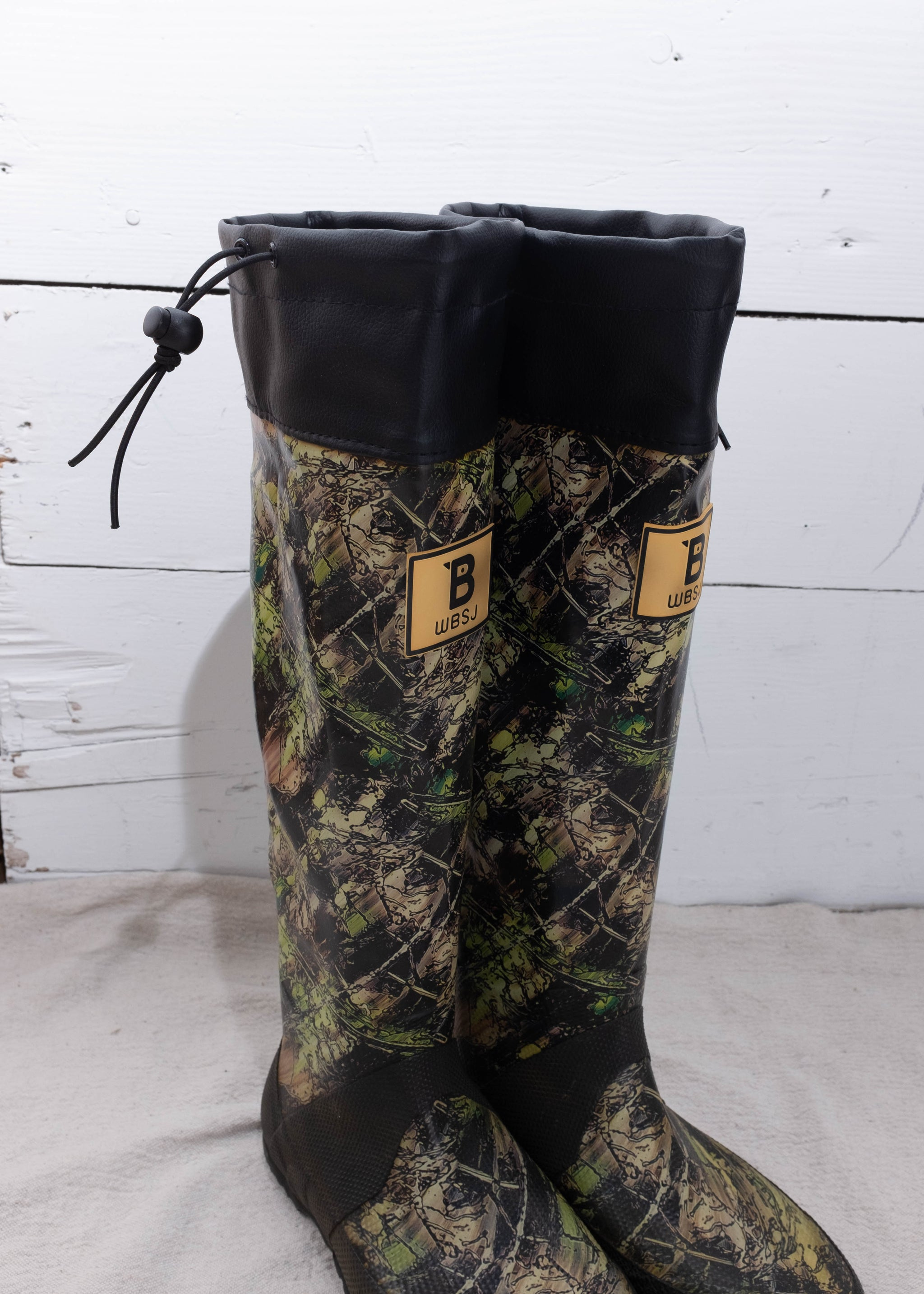 Printed heavy duty rain boots with drawstring.