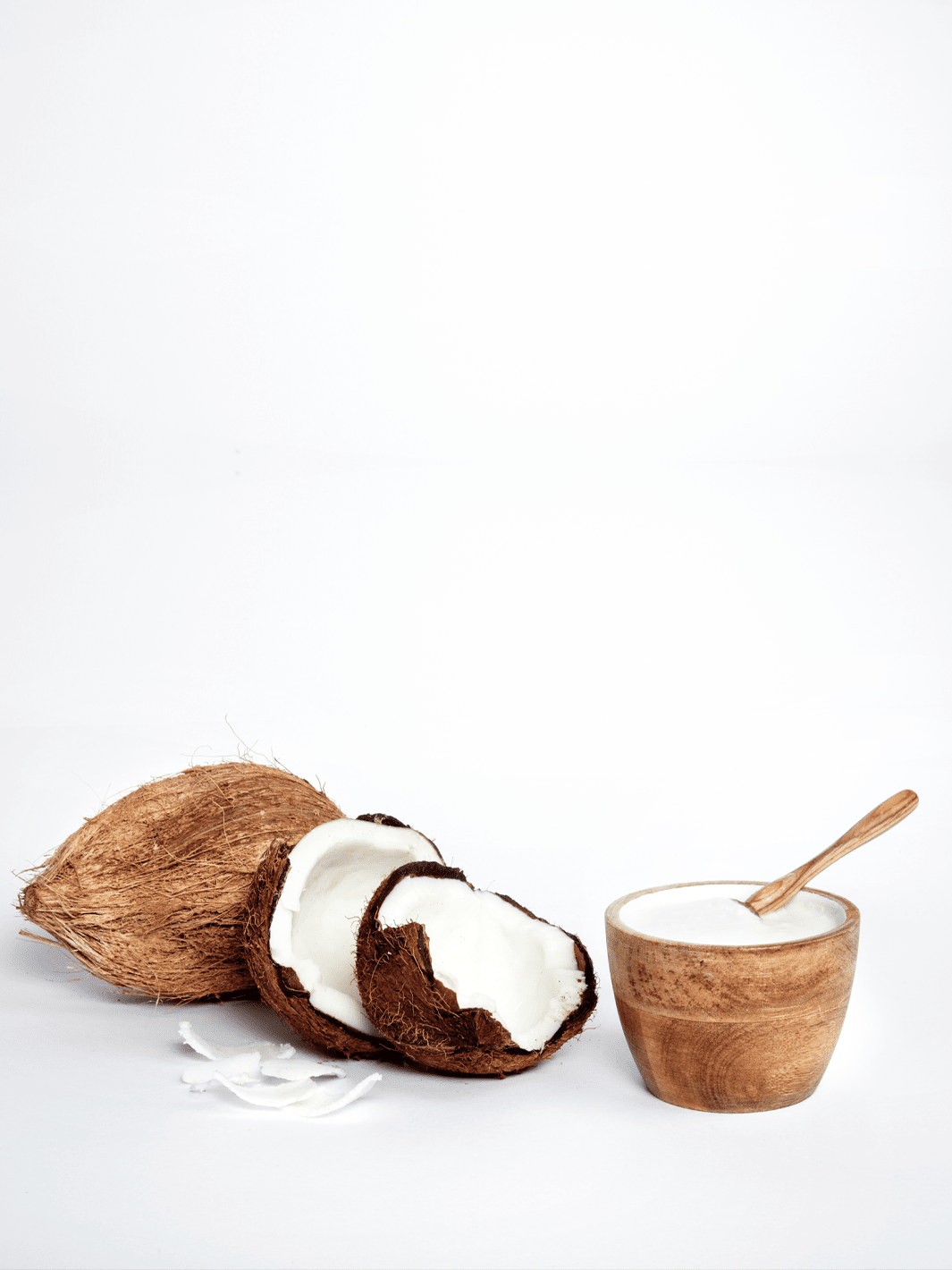 Coconuts and bowl of coconut milk