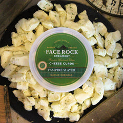Package of Face Rock Vampire Slayer Curds surrounded by loose curds